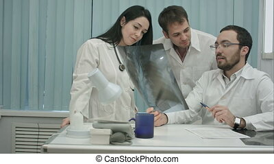 Portrait of young group of doctors looking at x-ray