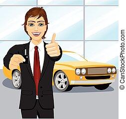 automobile salesman holding the key