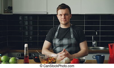 Portrait of young handsome caucasian executive chef in apron...