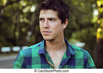 Portrait of Young handsome man, outdoors portrait, face