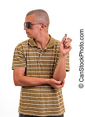 Portrait of young handsome man playing with a toy gun against white background