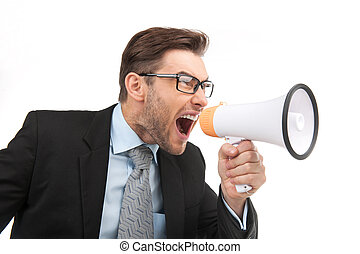 portrait of young handsome man shouting using megaphone. image of angry boss screaming on white background