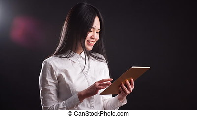 Portrait Of Young Happy Asian Woman Using Digital Tablet - isolated.