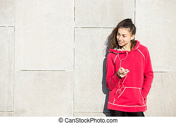Woman athlete runner holding smartphone