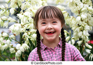 Portrait of young happy girl on flowers background.