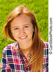 Portrait of young happy girl with long hair