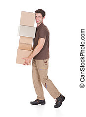 Man Carrying Stack Of Boxes