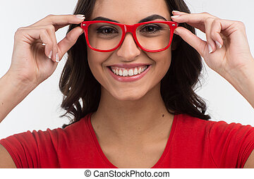 Portrait of young happy smiling cheerful woman. beautiful girl wearing red glasses