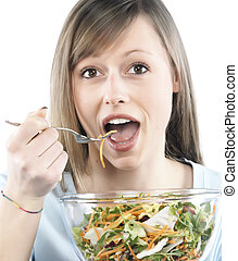 Portrait of young happy woman eating salad