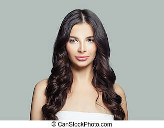 Portrait of young healthy woman. Cute girl with long curly hair and natural makeup