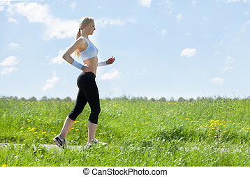 Young Healthy Woman Jogging In Park