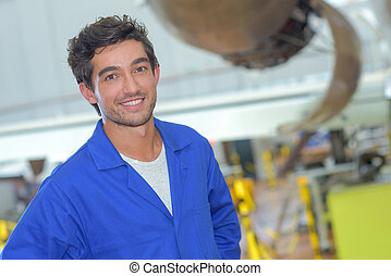portrait of young industrial worker posing