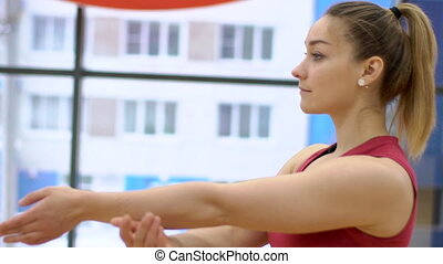 Portrait of young lady, who is having a training in modern gym, slow motion.