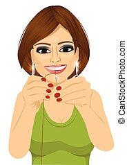 dressmaker woman putting sewing thread