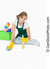Portrait of young maid cleaning floor
