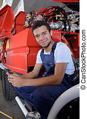 portrait of young maintenance engineer for the fire service