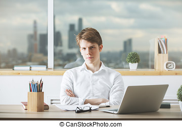 Portrait of young male at workplace