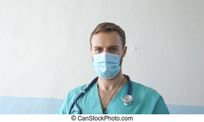 Portrait of young male caucasian doctor with medical face ...