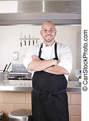 Portrait of young male chef in commercial kitchen