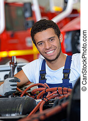 portrait of young male fire service mechanic