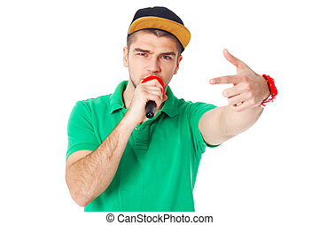 Portrait of young male hip hopper  singing in studio isolated on white.