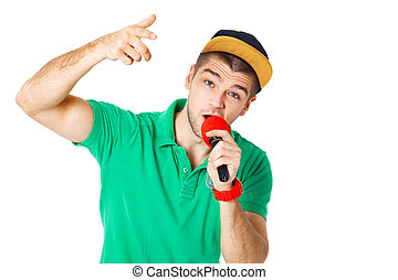 Portrait of young male hip hopper singing in studio isolated...