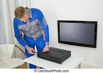 Technician Repairing Amplifier