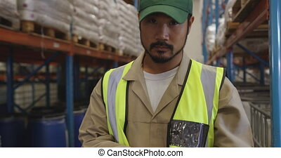Portrait of young male warehouse worker 4k