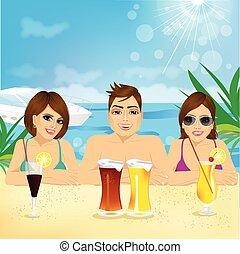 man and two woman enjoying beach holiday
