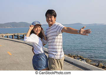 portrait of young man and woman relaxing and happy emotion on sea side use for people relax and feel free on vacation go to beautiful nature destination