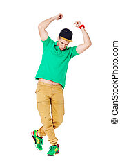 Portrait of young man b-boying in studio isolated on white.