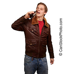 portrait of young man drinking beer against a white background