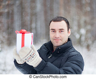 young man giving a gift