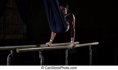 portrait of young man gymnasts competing in the stadium.