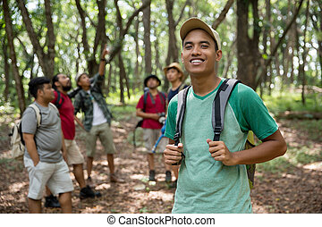 young man hiker smiling to camera