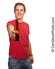 portrait of young man holding beer against a white background