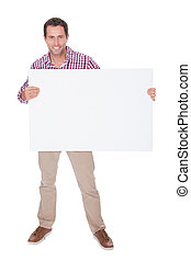 Portrait Of Young Man Holding Placard Isolated On White Background