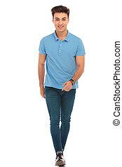 man in blue shirt walking to the camera