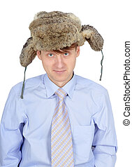 Portrait of young man in fur hat isolated on white background