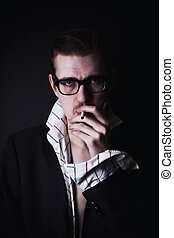 portrait of young man in glasses with cigarette