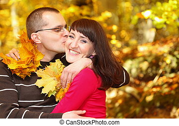 Portrait of young man kissing his girlfriend
