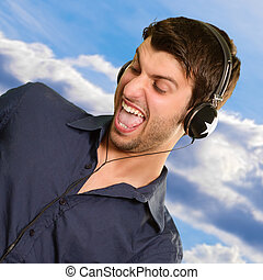 Portrait Of Young Man Listening Music