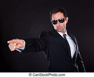 Portrait Of Young Man Points A Finger