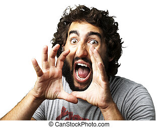 portrait of young man screaming against a white background
