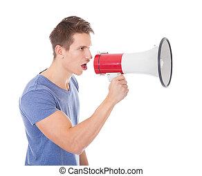 Portrait Of Young Man Shouting Through Megaphone