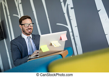 Portrait of young man sitting at desk in the office