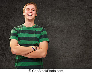 portrait of young man smiling against a grunge wall