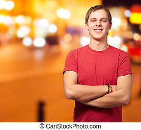 portrait of young man smiling against a night city