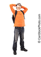 Portrait of young man stand with backpack  isolated on white background