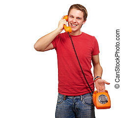 portrait of young man talking with vintage telephone over white background